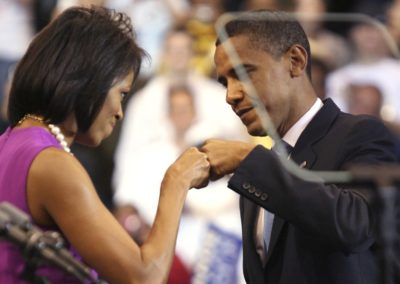 US Democratic presidential candidate Senator Barack Obama (D-IL) bumps fists with his wife Michelle (L) before his speech at his South Dakota and Montana presidential primary election night rally in St. Paul, Minnesota, June 3, 2008. REUTERS/Eric Miller