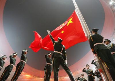 China's national flag is raised during the opening ceremony of the Beijing 2008 Olympic Games at the National Stadium in this August 8, 2008 file photo. REUTERS/Jerry Lampen